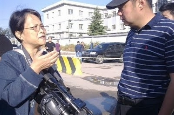 Ай Сяомин на месте событий. Фото с epochtimes.com