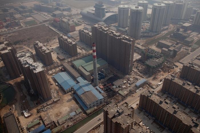 Рост цен на землю в Китае может привести к дальнейшему росту цен на недвижимость. Фото: Ed Jones/AFP/Getty Images