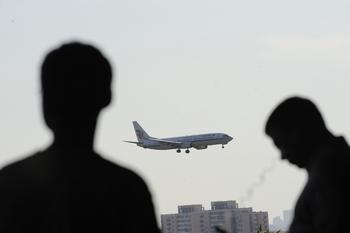 Китайские миллионеры уезжают из Китая. Фото: WANG ZHAO/AFP/GettyImages