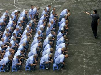 Система исправительных лагерей помогает режиму компартии репрессировать людей. Фото: Getty Images