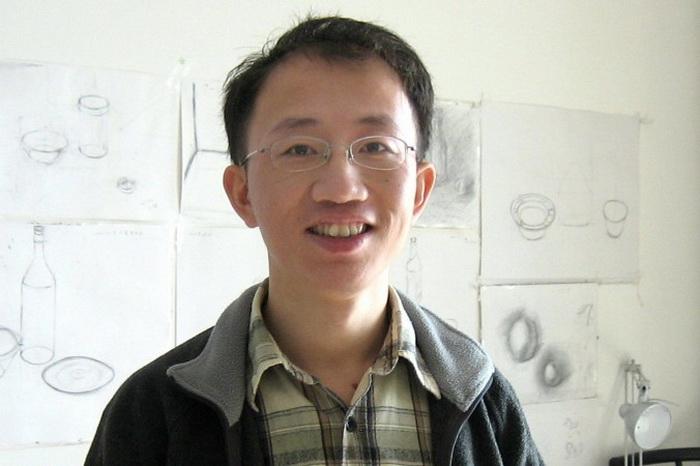 Правозащитник Ху Цзя встречается с иностранным журналистом в своём доме в Пекине 3 января 2007 г. Фото: VERNA YU/AFP/Getty Images