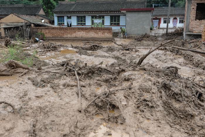 Сход оползней в китайской провинции Ганьсу привёл к гибели более 20 человек. Фото: ChinaFotoPress/Getty Images