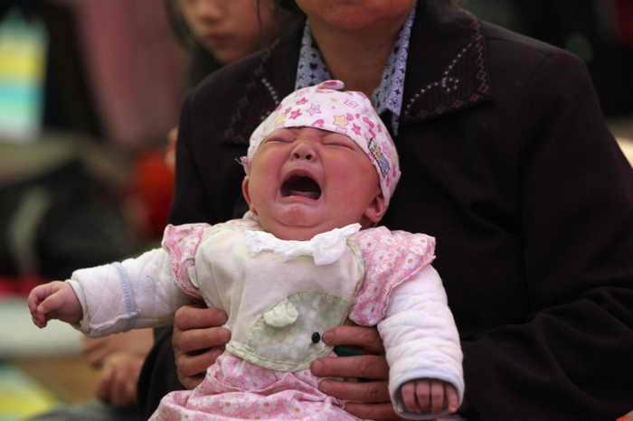 Китайская полиция недавно обнаружила в провинции Шаньдун  группу, торгующую детьми. Фото: AFP/GettyImages