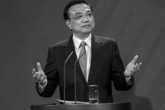 Китайский премьер-министр Ли Кэцян на пресс-конференции 26 мая 2013 г. в Берлине. Имя Ли Кэцяна связывают с экономической реформой в Китае, названной в его честь «ликономикой». Фото: Carsten Koall/Getty Images