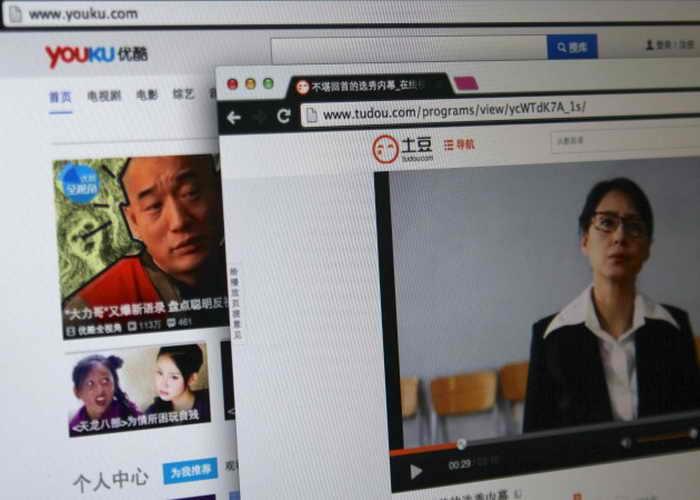 Китайские сайты Tudou и Youku. Новое постановление, согласно которому пользователи, размещающие видео в Интернете, должны указывать свои паспортные данные, затронет оба сайта. Фото: Epoch Times