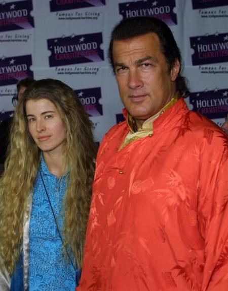 Стивен Сигал и его вторая супруга Адриен Ла-Русса. Фото: Jason Kirk/Getty Images