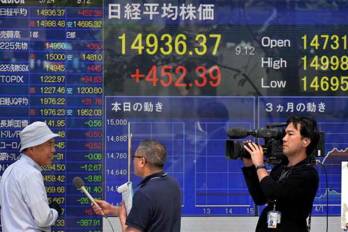 Промышленный спад в Китае привёл к обвалу фондового рынка. Фото: KAZUHIRO NOGI/AFP/Getty Images