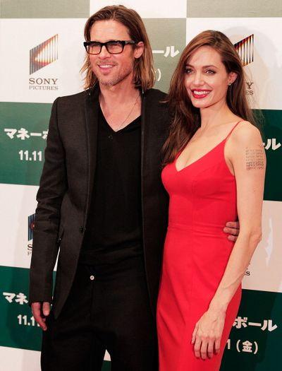 «Человек, который изменил все». Брэд Питт и Анджелина Джоли на премьере фильма «Человек, который изменил все» в Токио, Япония. Фото: Adam Pretty/Getty Images