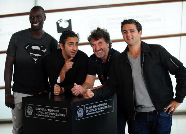 «1+1». Омар Си, режиссер Эрик Толедано, Франсуа Клюзе и режиссер Оливье Накаш представили киноленту «1+1» на Международном кинофестивале в Испании. Фото: RAFA RIVAS/AFP/Getty Images