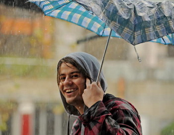Дождь. Фото: GREG WOOD/AFP/Getty Images