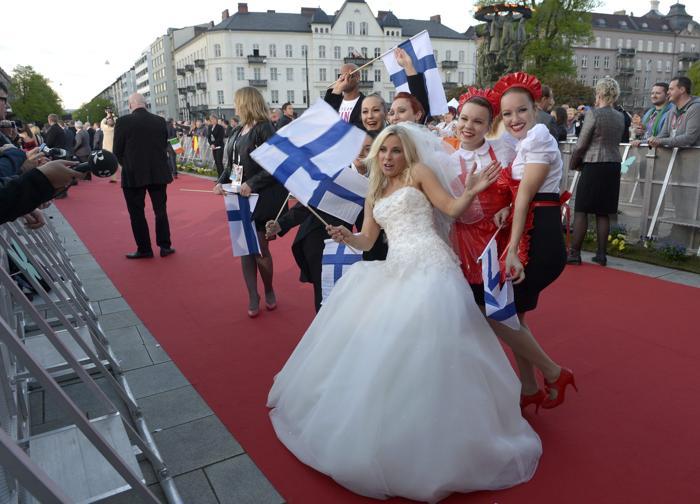 Криста Сиегфридс, представительница Финляндии, прибыла на церемонию открытия Евровидения 2013 в Мёльме, Швеция. Фото: Janerik Henriksson / SCANPIX/AFP/Getty Images