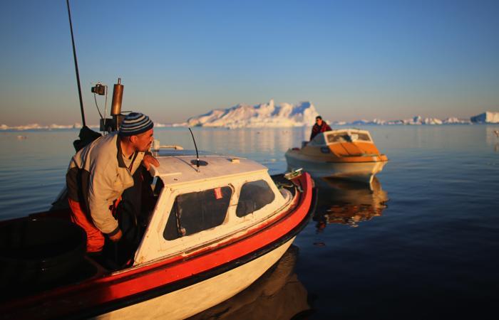 Исследователи Национального научного фонда и других организаций изучают явление таяния ледников и его долгосрочные последствия. Июль 2013 года. Фото: Joe Raedle/Getty Images