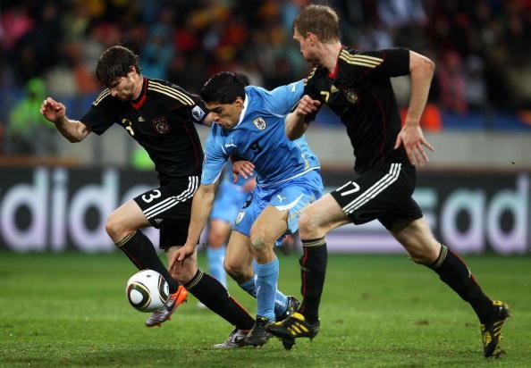 Кубок мира 2010. Германия - Уругвай - 3:2. Фото: Rodrigo ARANGUA, Johg MACDOUGALL, Franck FIFE, Carl de SOUZA/AFP/Getty Images