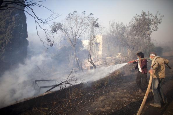 Пожар на Кармеле, близ Хайфы. «Водяные бомбардировщики» прибыли в Израиль для тушения природных пожаров под Хайфой, 4 декабря, Израиль. Фоторепортаж. Фото: MARCO LONGARI/AFP/Getty Images