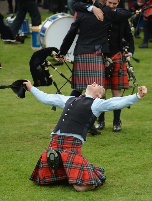 Ежегодный всемирный чемпионат оркестров волынщиков 2013 прошёл в столице Шотландии Глазго 17 и 18 августа 2013 года. Фото: Jeff J Mitchell/Getty Images