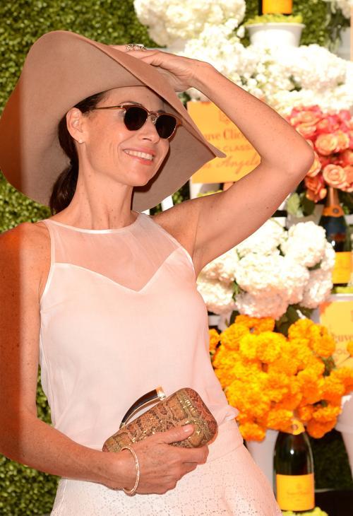 Актриса Минни Драйвер посетила благотворительный турнир по классическому поло, организованный с целью сбора средств на поддержание государственного исторического парка Лос-Анджелеса (США) 6 октября 2013 года. Фото: Jason Merritt/Getty Images for Veuve Clicquot