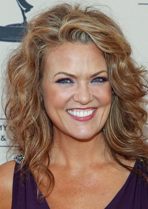 Звезда  телевидения Арианна Александр. Модные причёски представили знаменитости в августе 2013 года. Фото: Paul A. Hebert/Getty Images