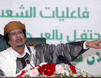 Муаммару Каддафи и его семье въезд в Россию запрещен. Фото: MAHMUD TURKIA/ AFP/Getty Images