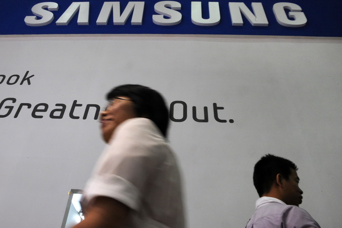 Samsung расследует обвинения в использовании детского труда. Фото: SAM YEH/AFP/GettyImages