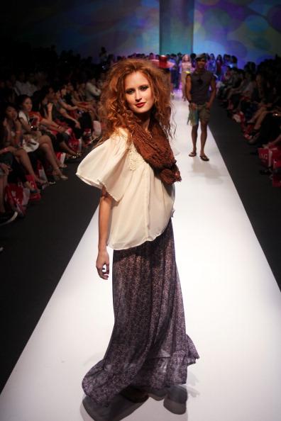 Фоторепортаж: Фестиваль моды Audi Fashion Festival 2011 в Сингапуре: Показ коллекции CLEO. Фото: Chris McGrath /Getty Images Entertainment