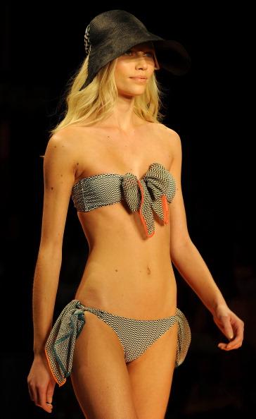 Фоторепортаж. Показ пляжной коллекции Salinas в рамках Rio Fashion Week, Summer 2012. Фото: VANDERLEI ALMEIDA/AFP