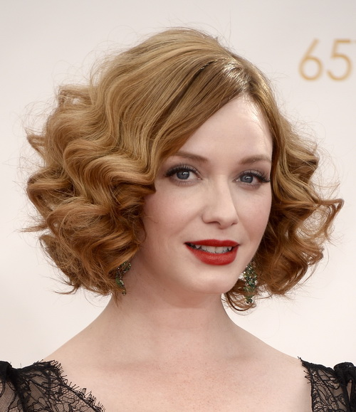 Кристина Хендрикс. Прекрасные звёздные дамы продемонстрировали свои стильные причёски и укладки на красной ковровой дорожке  65-й ежегодной церемонии вручения премии «Эмми», проходившая в театре «Нокиа» 22 сентября 2013 года в Лос-Анджелесе, США. Фото: Frazer Harrison/Getty Images