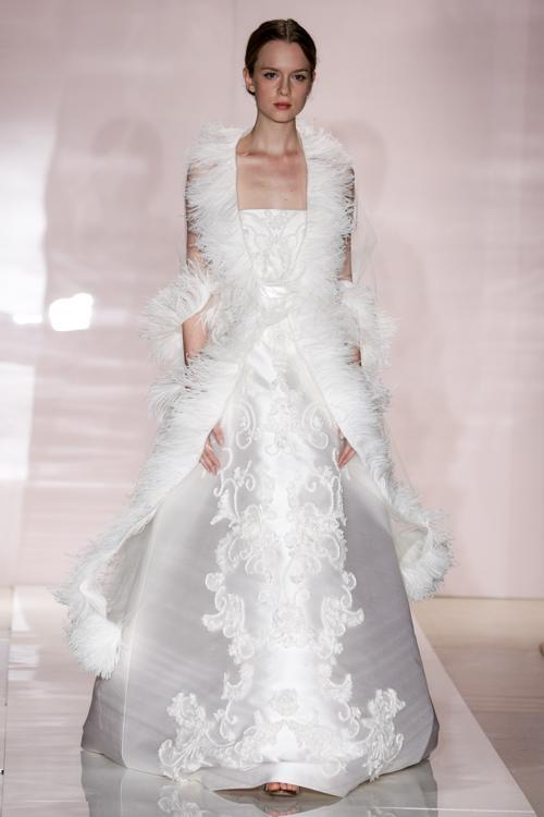 Известный дизайнер Рима Акра, чьи свадебные платья выбирали Анджелина Джоли, Дженнифер Лопес и другие знаменитости, представила 11 октября 2013 года новую коллекцию Reem Acra осень 2014 на Неделе свадебной моды в Нью-Йорке. Фото: Thomas Concordia/Getty Images