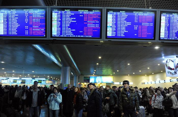 В Московском аэропорту Домодедово. Фото: NATALIA KOLESNIKOVA/AFP/GettyImages