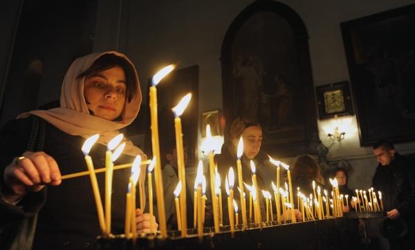 Рождество Христово. Рождественская служба в Тбилиси, Грузия. Фото: VANO SHLAMOV/AFP/Getty Images