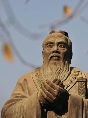 Комментарии Конфуция о тщеславии и достоинстве. Фото:  FREDERIC J. BROWN/AFP/Getty Images