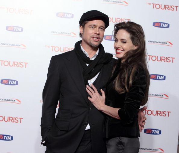 Анджелина Джоли и Брэд Питт на  премьере фильма «Турист» в Риме. Италия, 15 декабря 2010. Фото: Elisabetta Villa/Getty Images