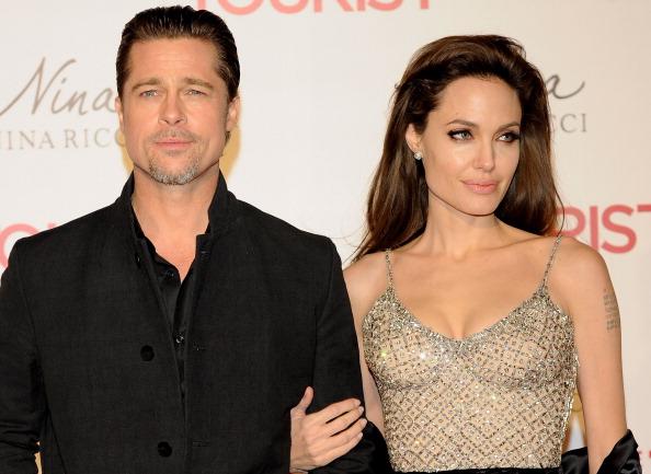 Анджелина Джоли и Брэд Питт, 16 декабря 2010, Мадрид, Испания. Фото: Carlos Alvarez/Getty Images
