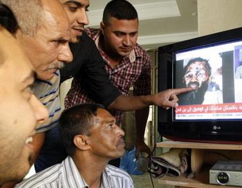 Реакция русской блогосферы на убийство Бен Ладена. Фото: SABAH ARAR/AFP/Getty Images