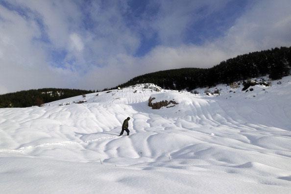Горы в снегу. Фото: JOSEPH EID /AFP/Getty Images