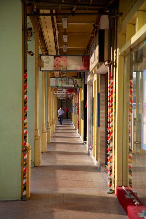 Дома с магазином или офисом распространены в Сингапуре и представляют архитектурное историческое наследие социального развития стран юго-восточной Азии. Фото: Nicky Loh/Getty Images