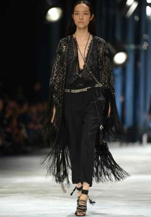 Фэй Фэй Сунь  участвует в показе весенне-летней коллекции – 2014 Roberto Cavalli  во время недели моды в Милане 21 сентября 2013 г.  Фото: FILIPPO MONTEFORTE/AFP/Getty Images