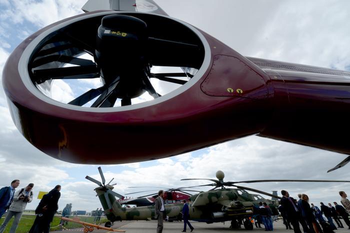 Военные вертолёты на открытии Международного авиационно-космического салона МАКС-2013 в Жуковском 27 августа 2013 года. Фото: KIRILL KUDRYAVTSEV/AFP/Getty Images