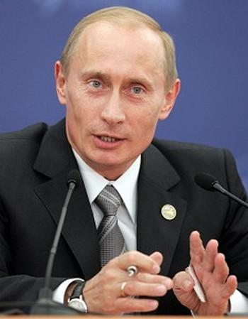 Премьер Владимир Путин отметил новый статус школьного библиотекаря. Фото: DENIS SINYAKOV/AFP/Getty Images