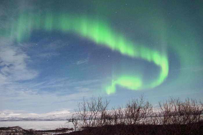 Северное сияние в шведской Лапландии,как следствие магнитной бури на Солнце. Фото: FRANCбOIS CAMPREDON/AFP/Getty Images