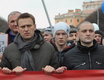 Сторонники оппозиции Сергей Удальцов и Алексей Навальный. Фото: OLGA MALTSEVA/AFP/Getty Images