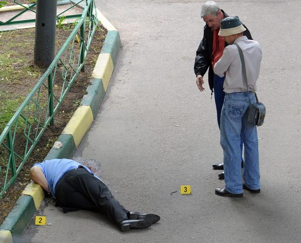 Киллеры стреляли в полковника Буданова на глазах у жены. Фото: NATALIA KOLESNIKOVA/AFP/Getty Images