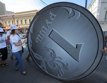 Необъяснимая ротация денег прошла путем инвестиций в России. Фото: ALEXANDER NEMENOV/AFP/Getty Images