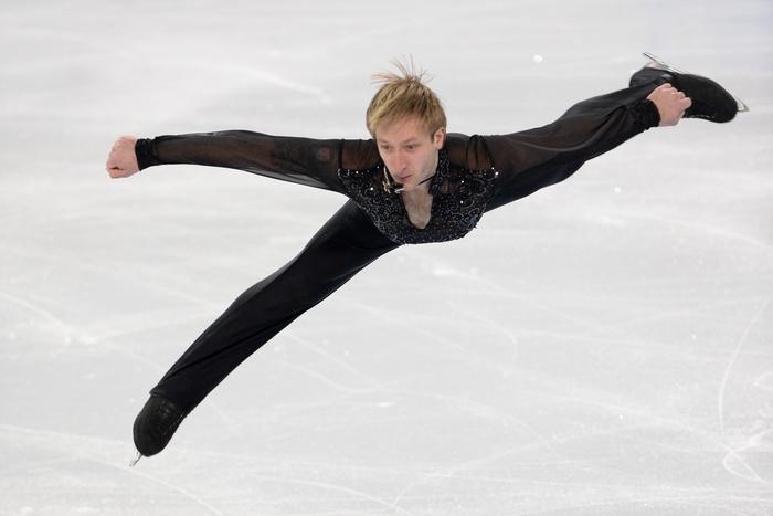 Двукратный олимпийский чемпион российский фигурист Евгений Плющенко, 9 февраля 2014 год, Олимпиада в Сочи. Фото: ANDREJ ISAKOVIC/AFP/Getty Images