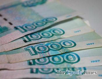 В подарок на Новый год россияне мечтают получить деньги. Фото: Великая Эпоха (The Epoch Times)