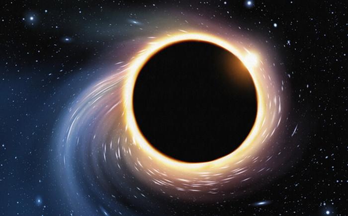 Иллюстрация чёрной дыры. Японские ученые вычислили внутреннюю энергию чёрной дыры из гипотетического космоса с меньшим количеством измерений. Сходство подтверждает теорию, что вселенная — это голограмма. Фото: Shutterstock*