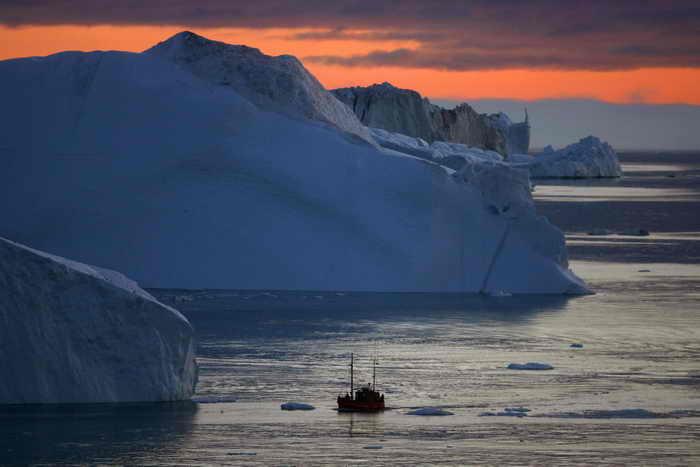 Большое количество метана выделяется, когда тают ледники океана. Фото: Uriel Sinai/Getty Images