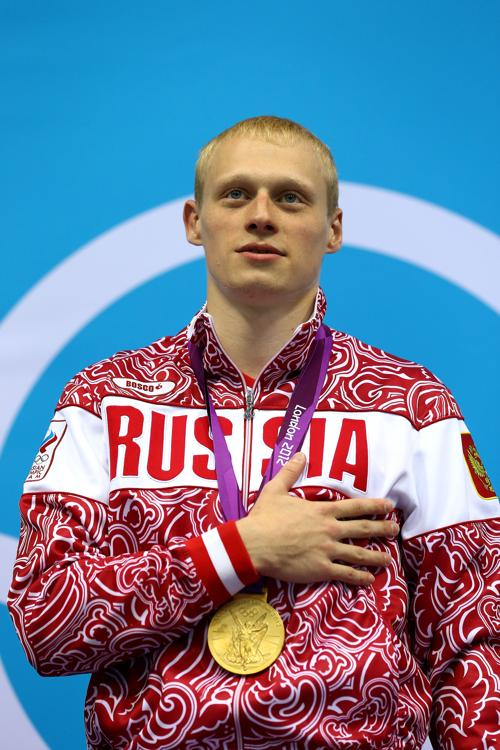 Илья Захаров, прыгун в воду с 3-метровой высоты, завоевал золото Олимпиады Лондона. Фоторепортаж. Фото: Al Bello/Getty Images