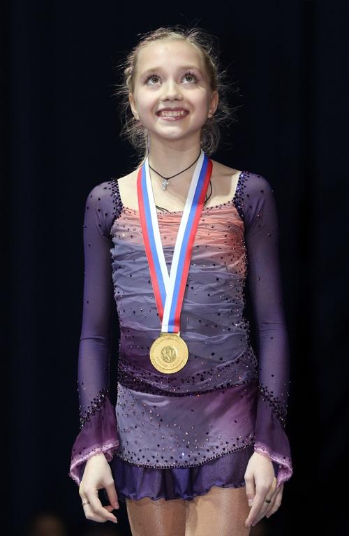 Елена Радионова  в одиночном фигурном катании среди юниорок в финале Гран-при,  проходившем в ледовом дворце в Сочи 8 декабря 2012 года, завоевала золото. Фото: Julian Finney/Getty Images