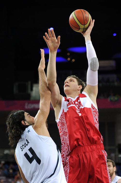 Фоторепортаж с баскетбольного матча Россия - Аргентина. Фото: Garrett W. Ellwood/NBAE via Getty Images
