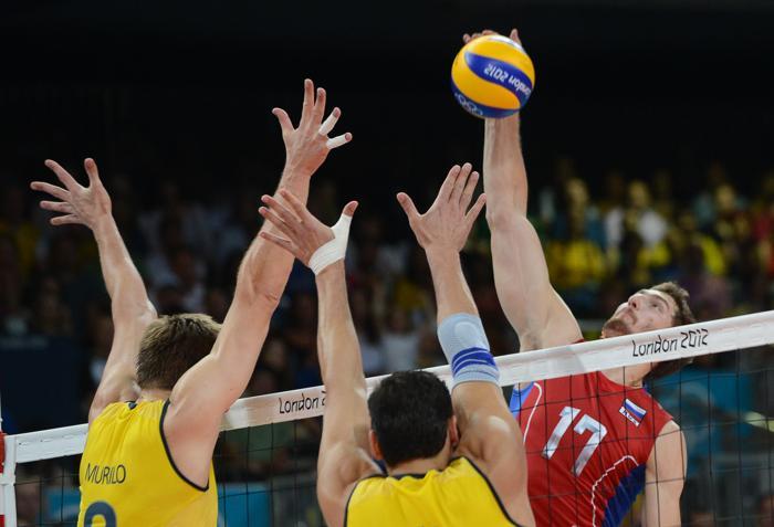 Российские волейболисты впервые стали чемпионами Олимпийских игр. Фоторепортаж с финального матча по волейболу  Россия – Бразилия. Фото: ALBERTO PIZZOLI/AFP/GettyImages